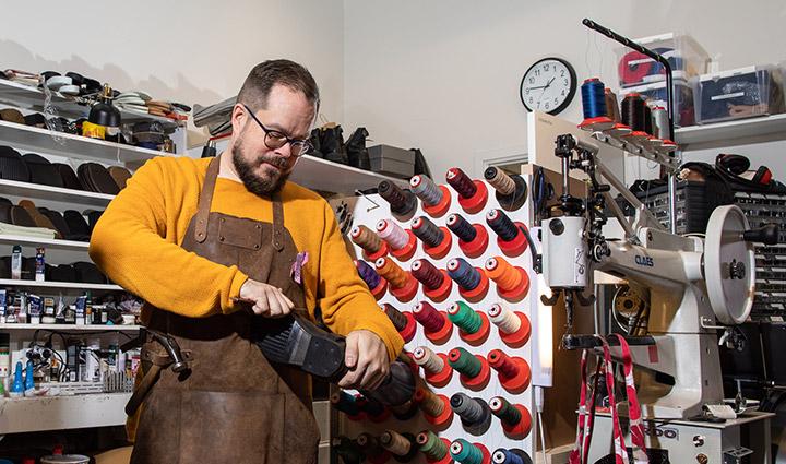 A man working in shoe repair.